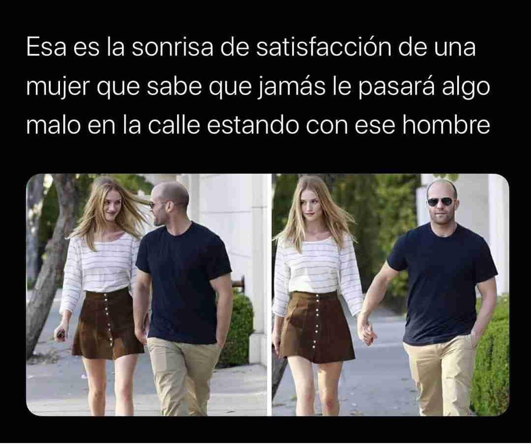 Esa es la sonrisa de satisfacción de una mujer que sabe que jamás le pasará algo malo en la calle estando con ese hombre.